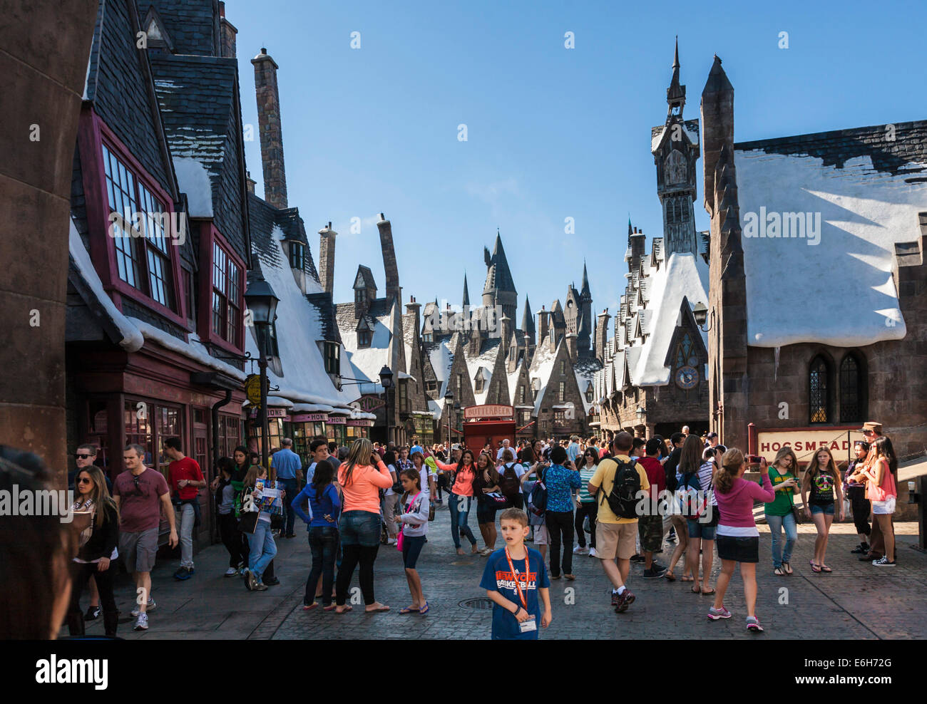 Park guests pose for photographs in The Wizzarding World of Harry Potter at Universal Studios, Orlando, Florida - Stock Image