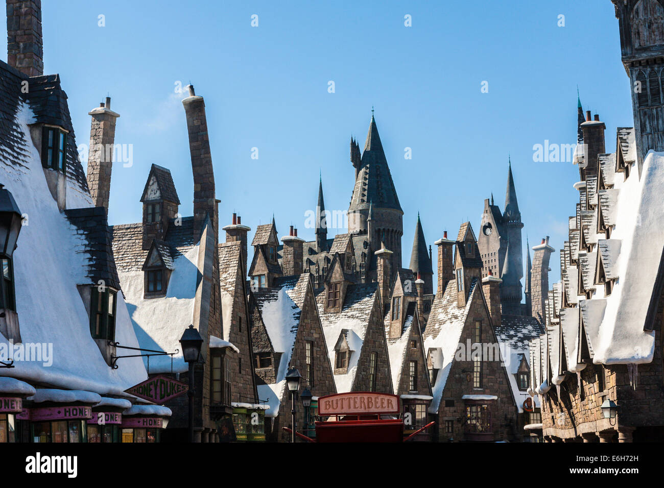 Snow covered rooftops in the village of Hogsmeade at The Wizzarding World of Harry Potter in Universal Studios, - Stock Image