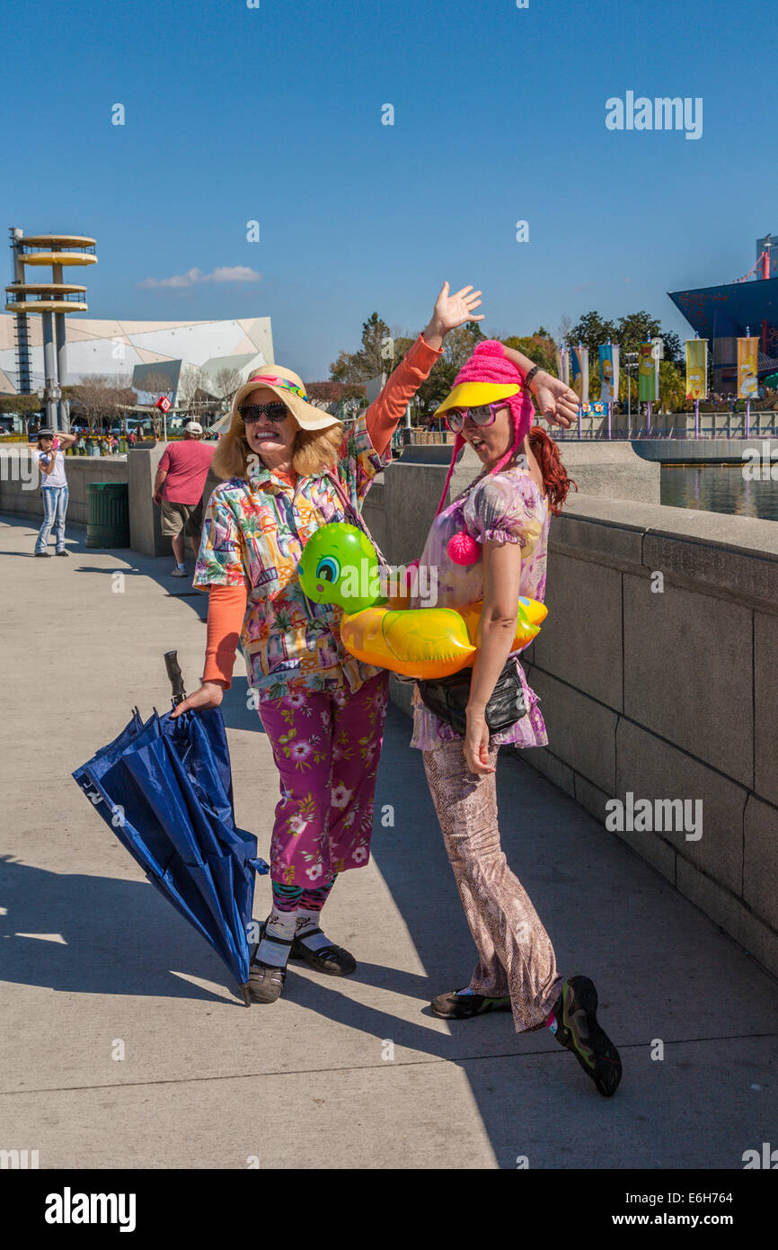 Two female staff members dressed up in colorful clothing at Universal Studios theme park in Orlando, Florida - Stock Image