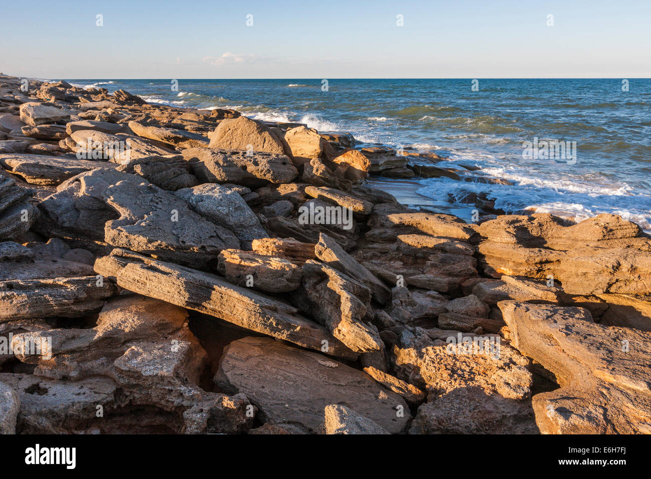 Coquina rock formations along coast of Atlantic Ocean at Washington Oaks Gardens State Park in Palm Coast, Florida, - Stock Image