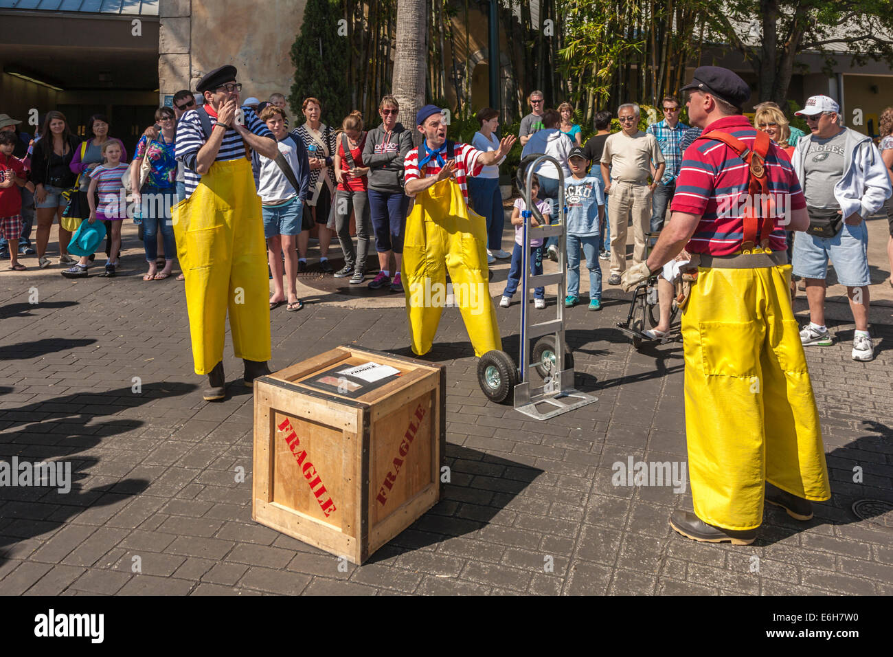 Street performers doing comedy act on streets at Sea World theme park in Orlando, Florida - Stock Image