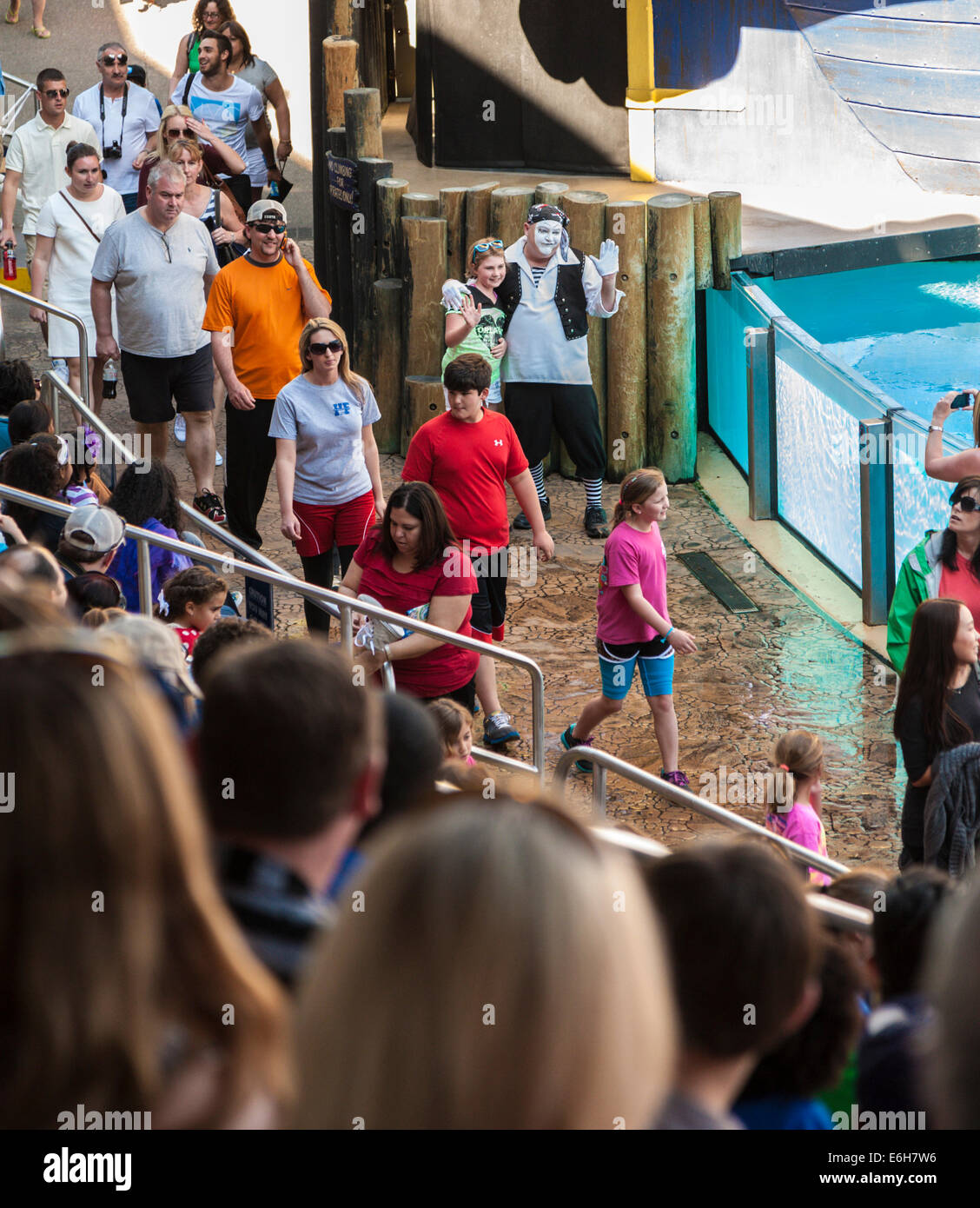 Mime poses for photo while keeping crowd entertained before the Clyde and Seamore sea lion show at Sea World in Stock Photo