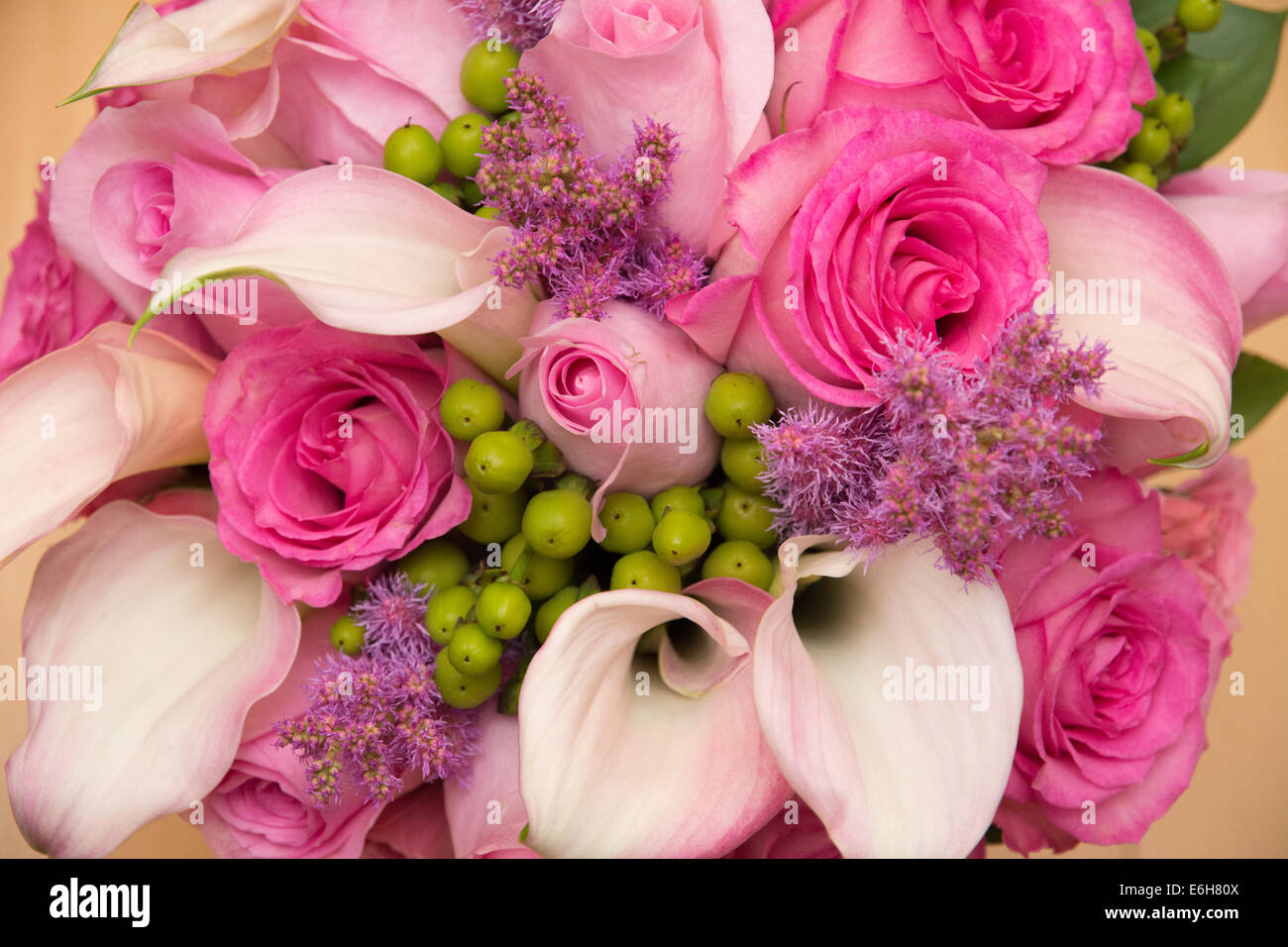Pink calla lily bouquet stock photos pink calla lily bouquet stock a bouquet of flowers in beautiful pink colors roses and calla lillies stock izmirmasajfo