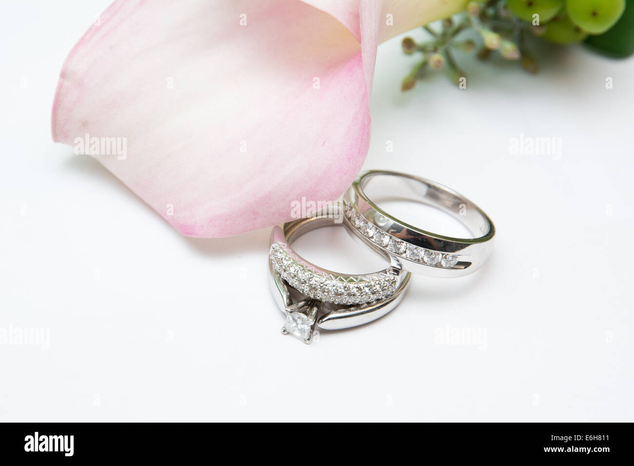 White Gold And Diamond Wedding Rings And An Engagement Ring Are