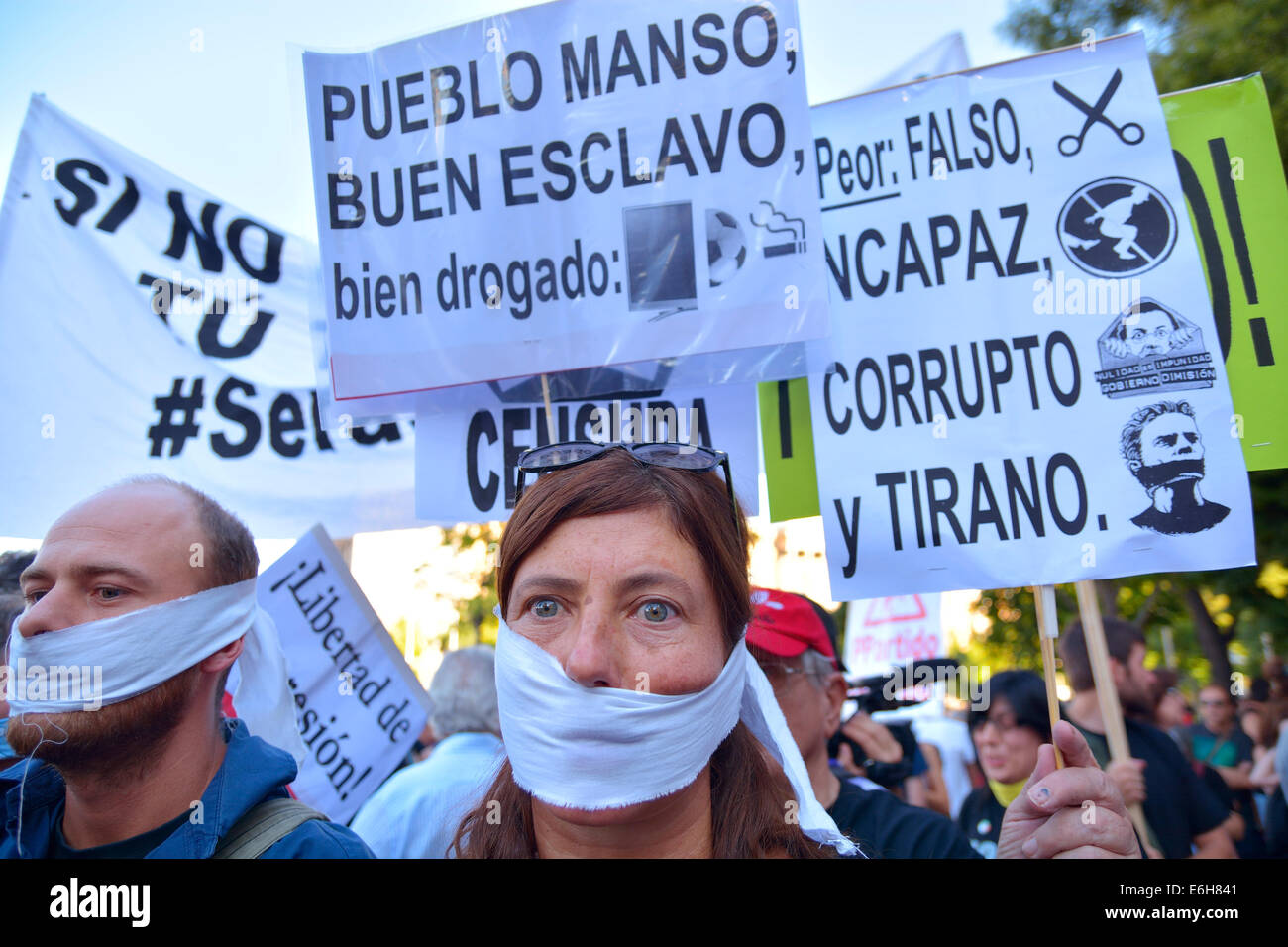 People with their mouths covered complaining against anti-protest law (Gag Law) at a demonstration in Madrid on - Stock Image