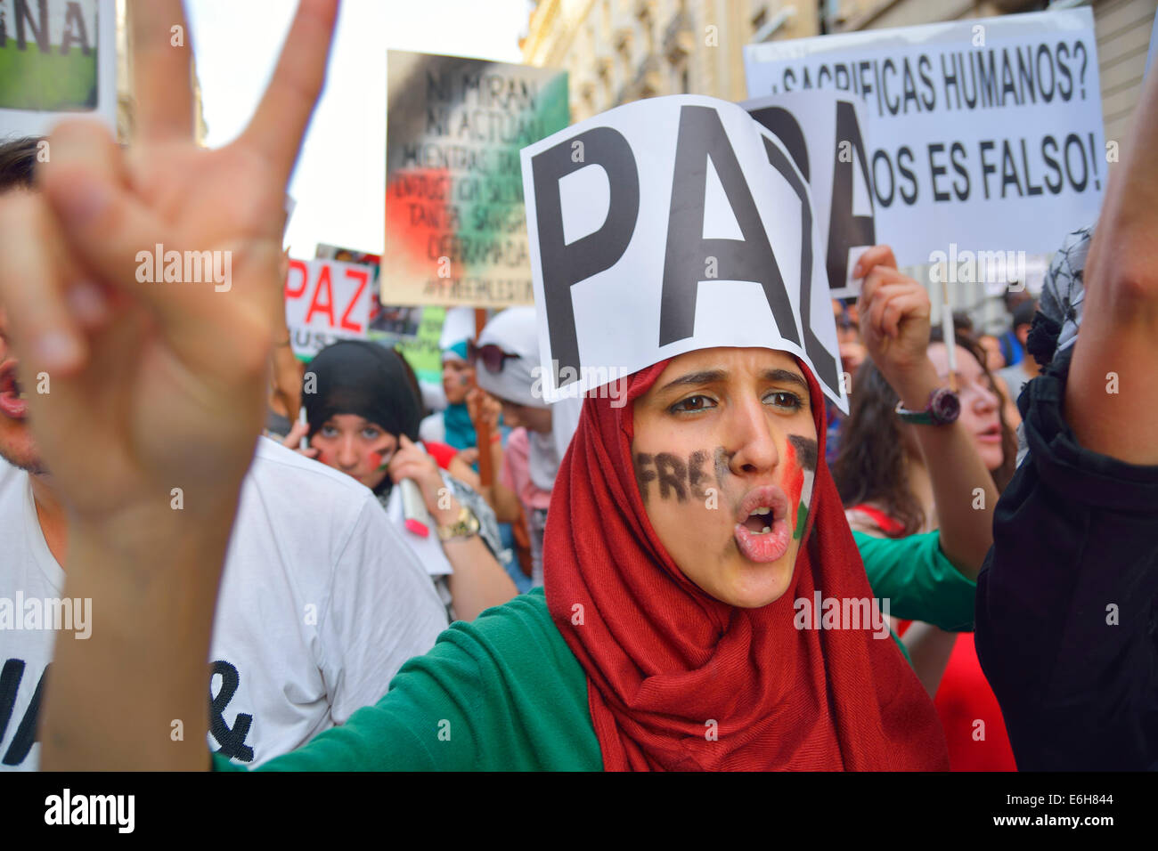 Palestinian woman demanding peace and protesting against Israeli attacks in the Gaza Strip during a demonstration - Stock Image