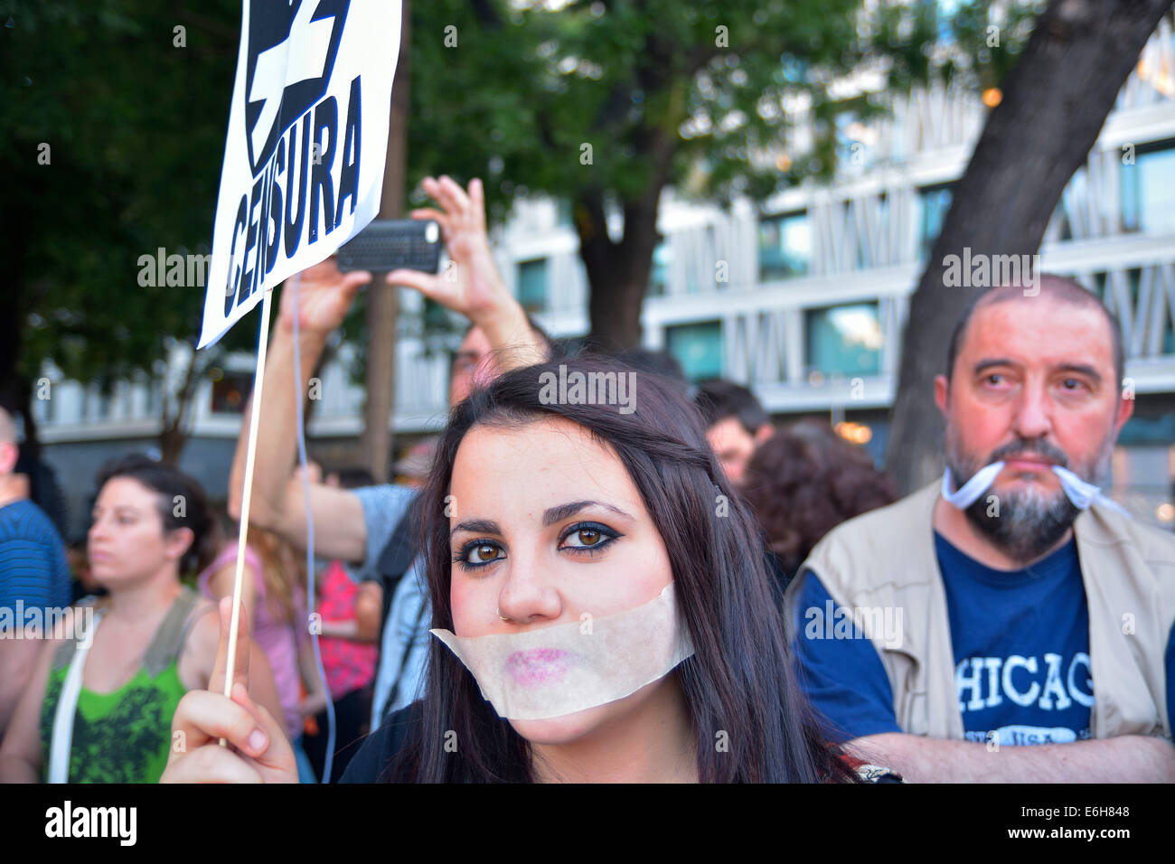 Young woman with her mouth covered complaining against anti-protest law (Gag Law) at a demonstration in Madrid on - Stock Image