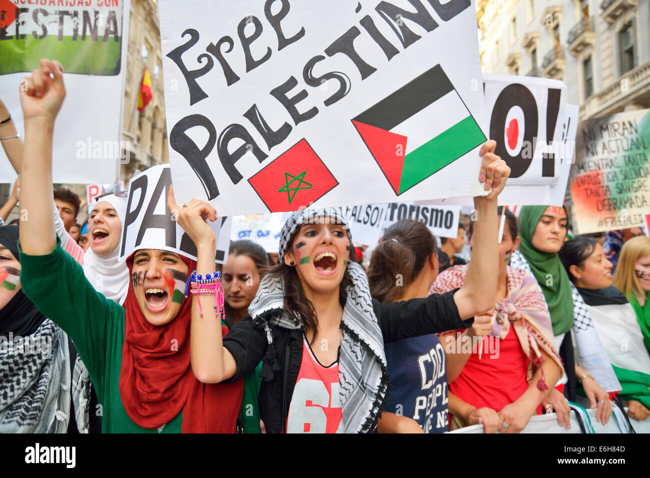 Women demanding a free Palestine and protesting against Israeli attacks in the Gaza Strip during a demonstration - Stock Image
