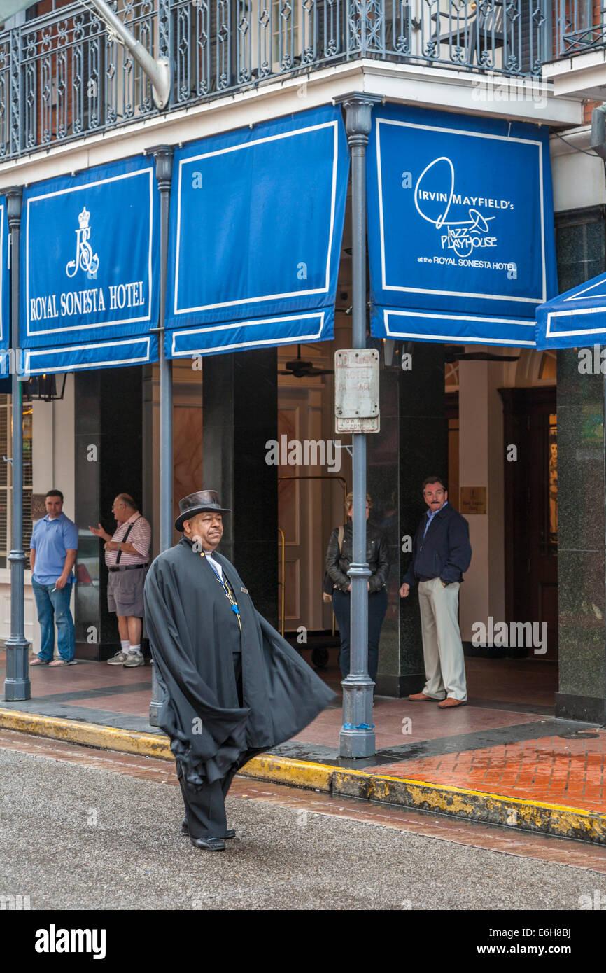 Porter Standing In Street Outside The Royal Sonesta Hotel On Bourbon
