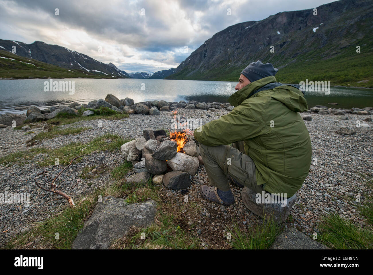 sitting by the fire in Jotunheimen National Park, Norway - Stock Image