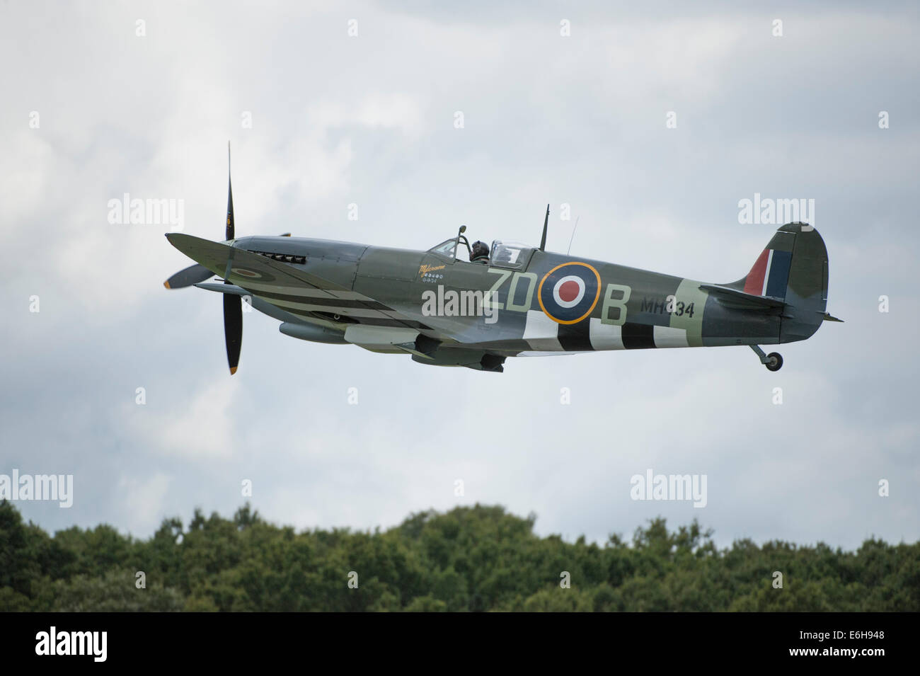 Dunsfold Aerodrome, Surrey UK. Saturday 23rd August 2014. Spitfire MK 1XB World War II fighter taking off at the - Stock Image
