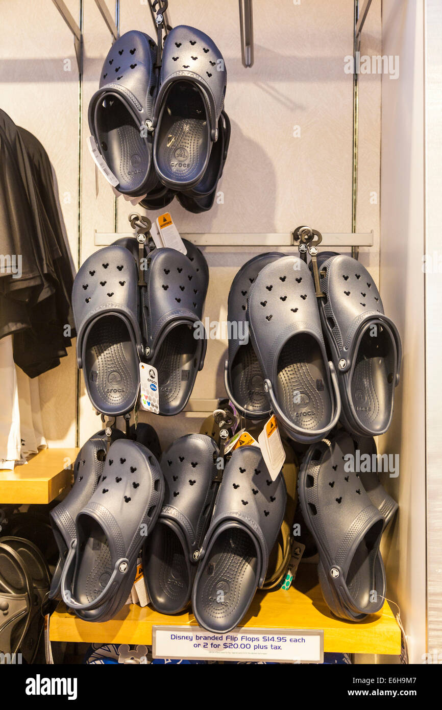Disney branded Croc shoes for sale in the Contemporary Resort hotel at Walt Disney World, Florida - Stock Image