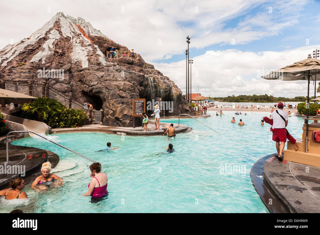 Guests enjoying the swimming pool at the Polynesian Resort in Walt Disney World, Florida - Stock Image