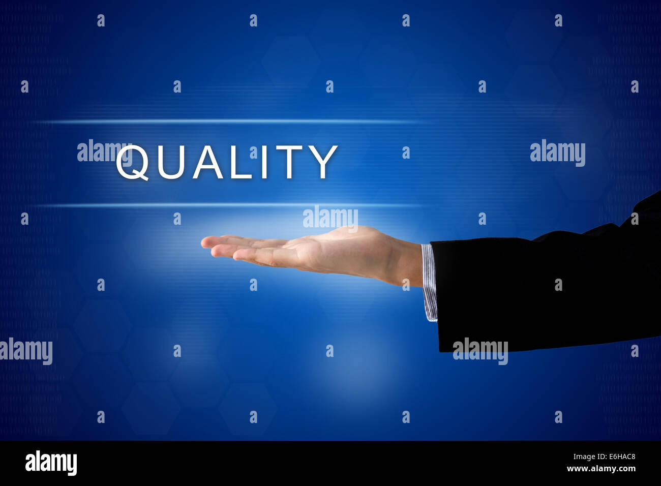 quality button with business hand on a touch screen interface - Stock Image
