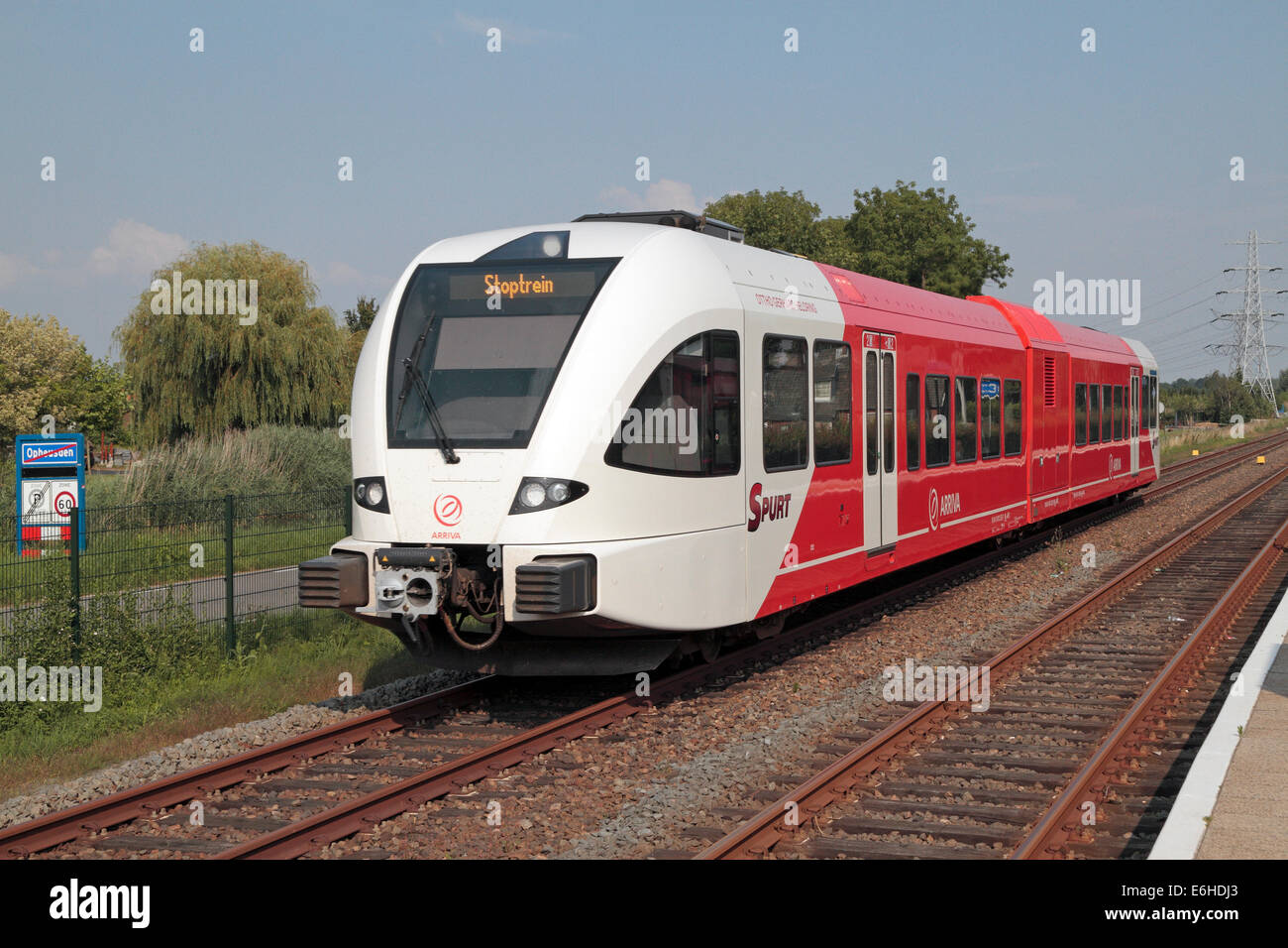 An Arriva Netherlands 'Spurt' train passing at Opheusden station, Gelderland, Netherlands. - Stock Image