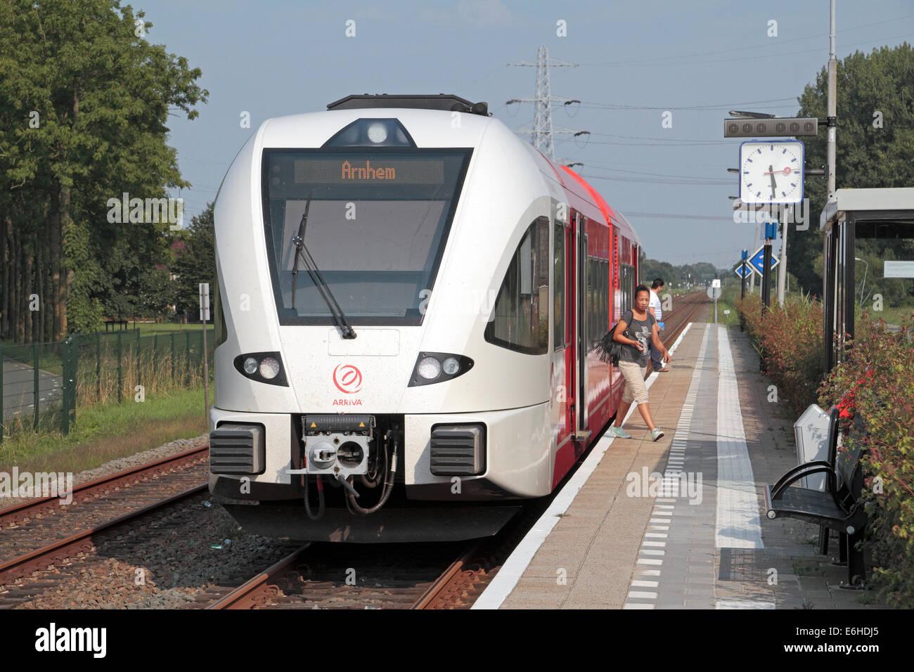 An Arriva Netherlands 'Spurt' train stopped at Opheusden station, Gelderland, Netherlands. - Stock Image
