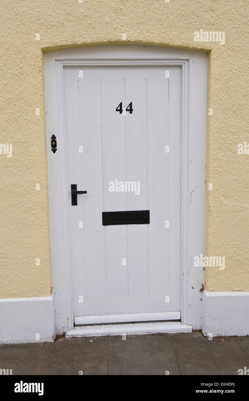 White number 44 wooden front door of period terraced house in Brecon Powys Wales UK & White number 44 wooden front door of period terraced house in Brecon ...