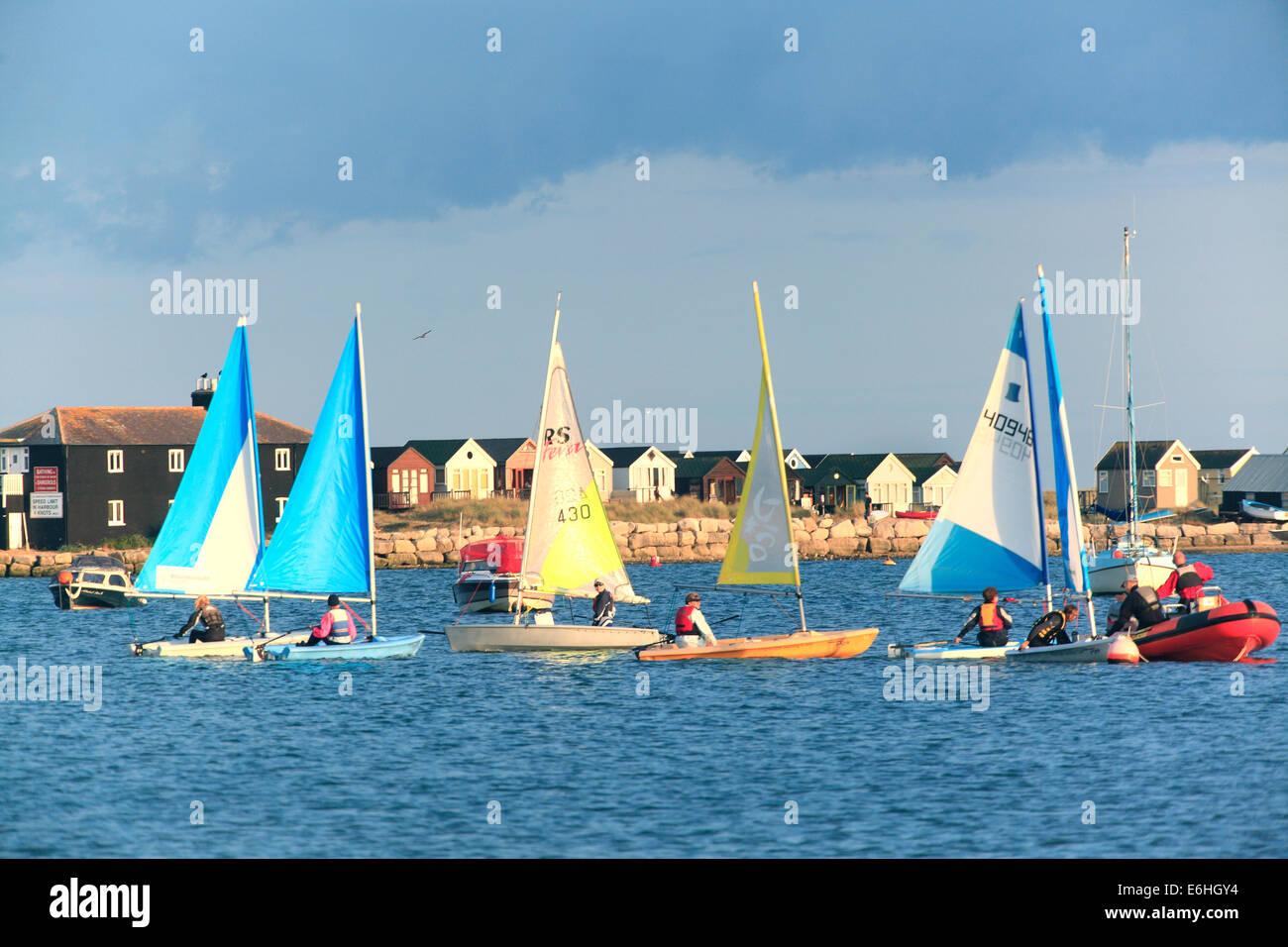 Sailing in Mudeford  Bay Hengistbury Head - Stock Image