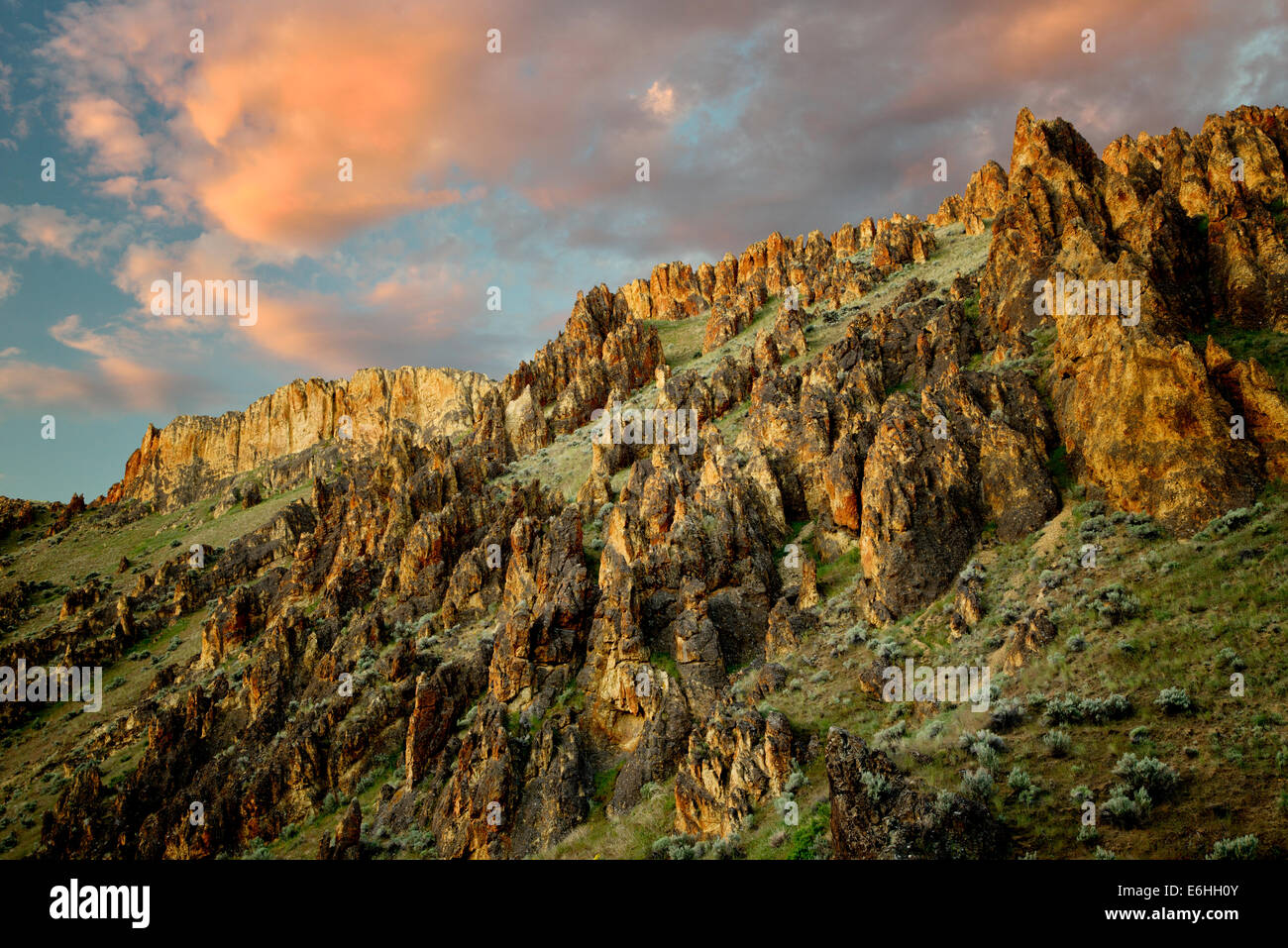 Rock formations and clouds in Leslie Gultch. Malhuer County, Oregon - Stock Image