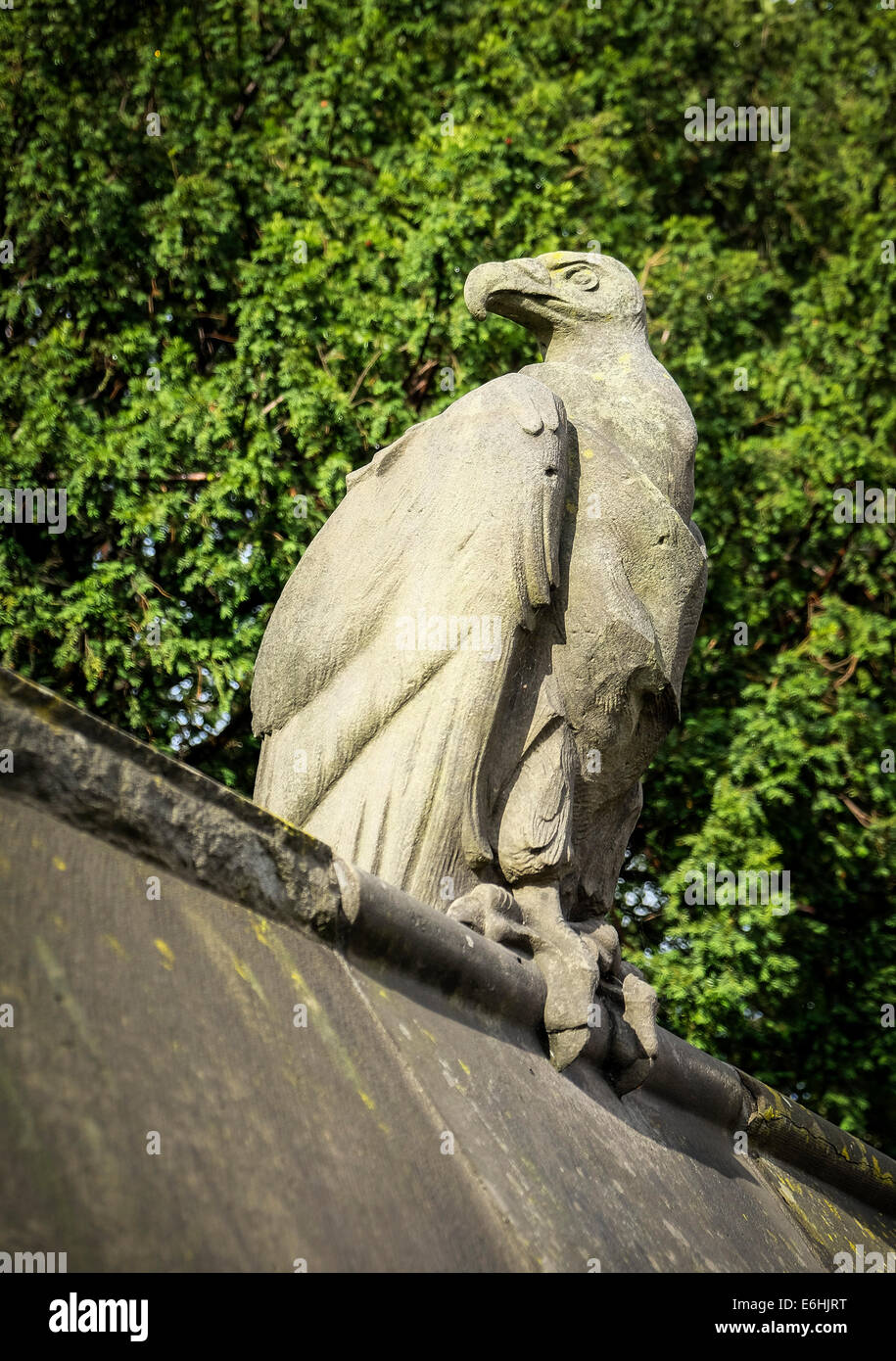 The sculpture of a Vulture on the Animal Wall at Cardiff Castle. - Stock Image
