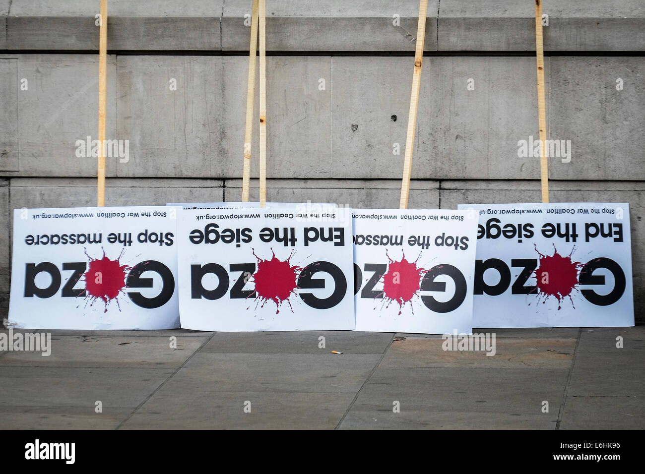 Placards stacked against a wall for use by Pro-Palestinian protesters at a demonstration outside Downing street - Stock Image