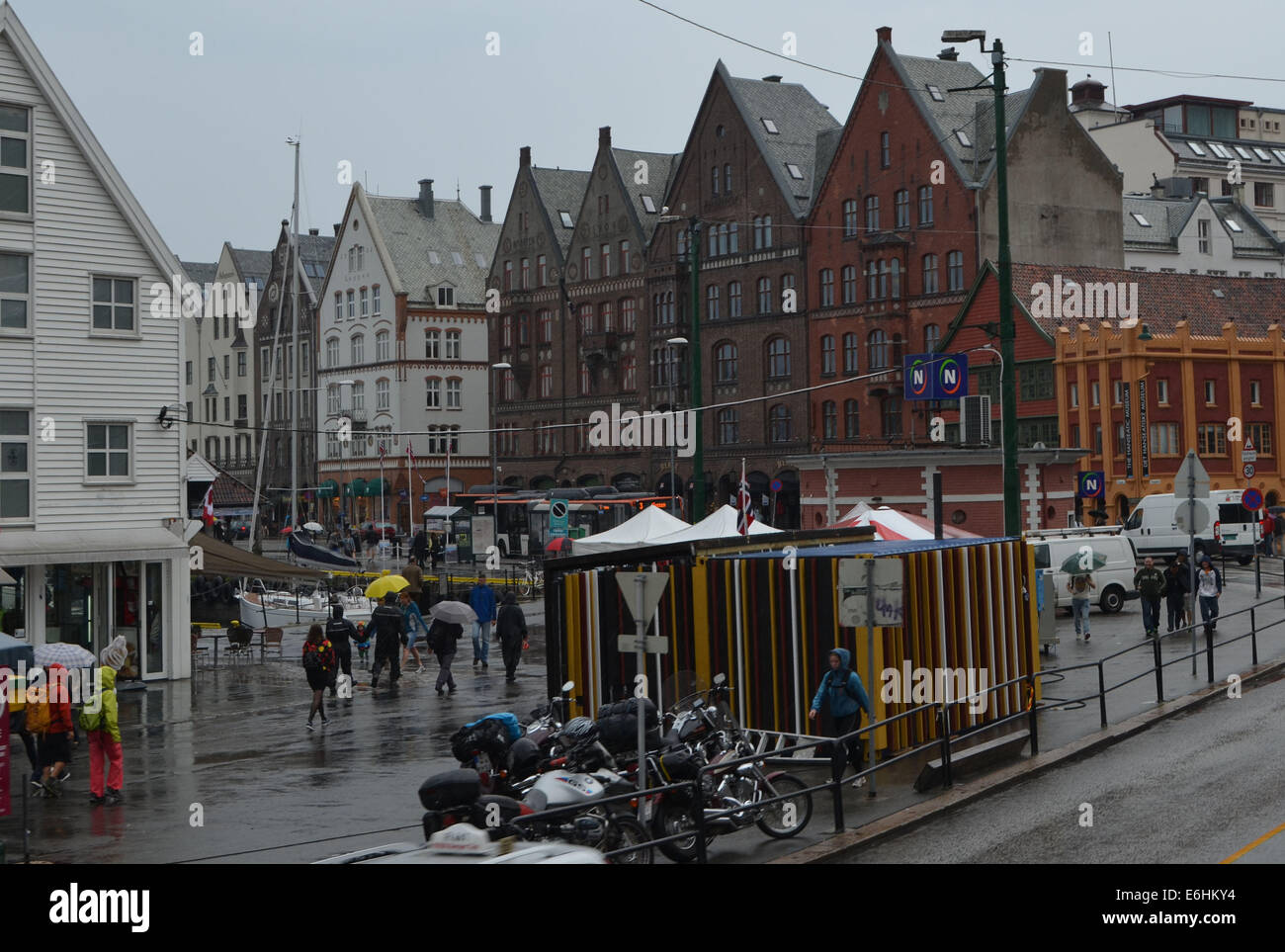 A rainy day in Bergen. It had been raining heavily all day. Umbrellas  against the rain and still you got soaking. - Stock Image