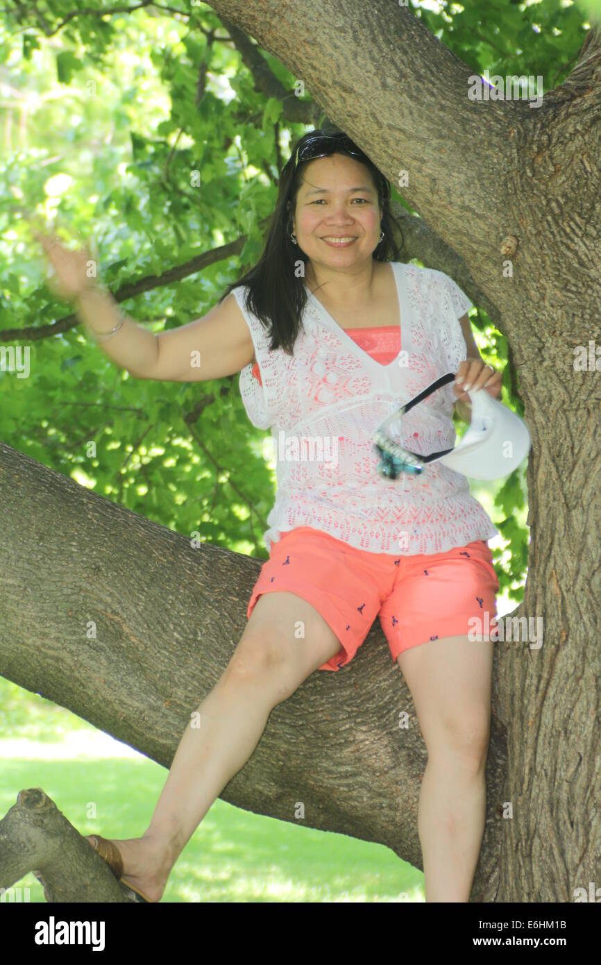mature asian woman wearing shorts stock photos & mature asian woman