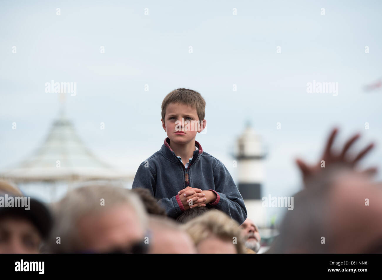 Southsea, UK. 24th Aug, 2014. Victorious Festival - Sunday, Southsea, Hampshire, England. A young festival goer - Stock Image