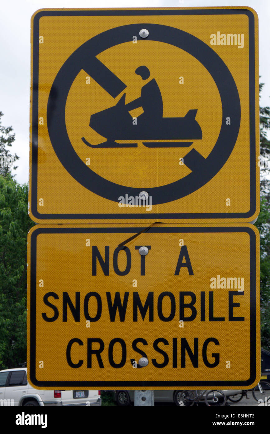A sign saying Not A Snowmobile Crossing - Stock Image