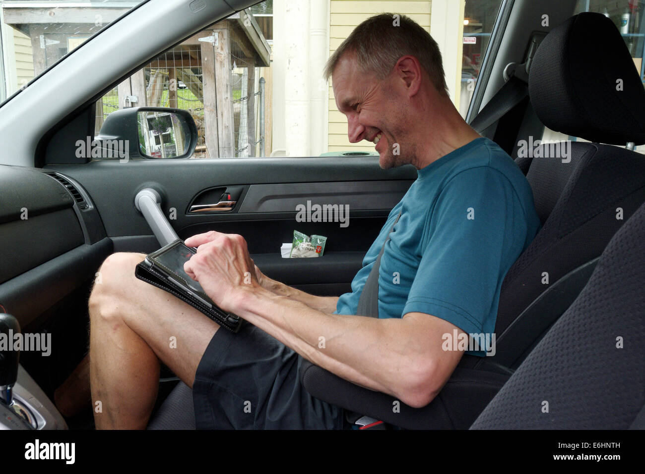 Middle Aged Man In The Seat Of A Car Stock Photos & Middle Aged Man