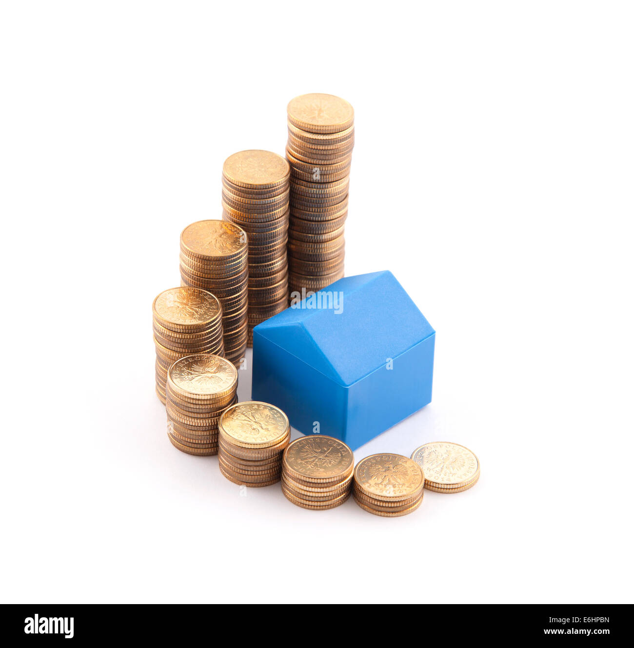 Blue house with stack of coins - Stock Image