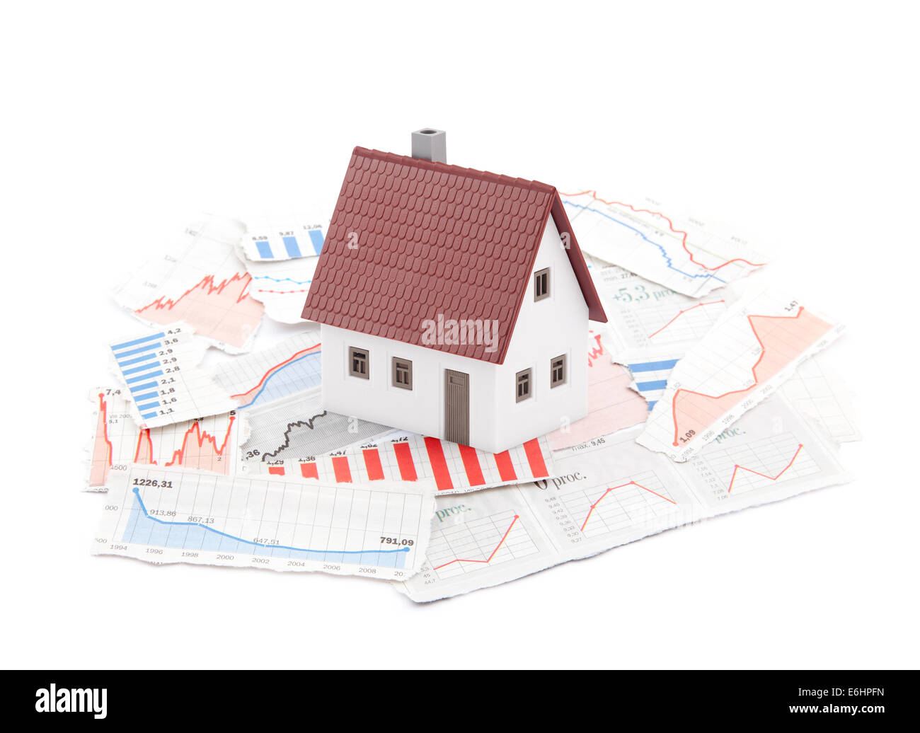 Small house on newspaper charts - Stock Image
