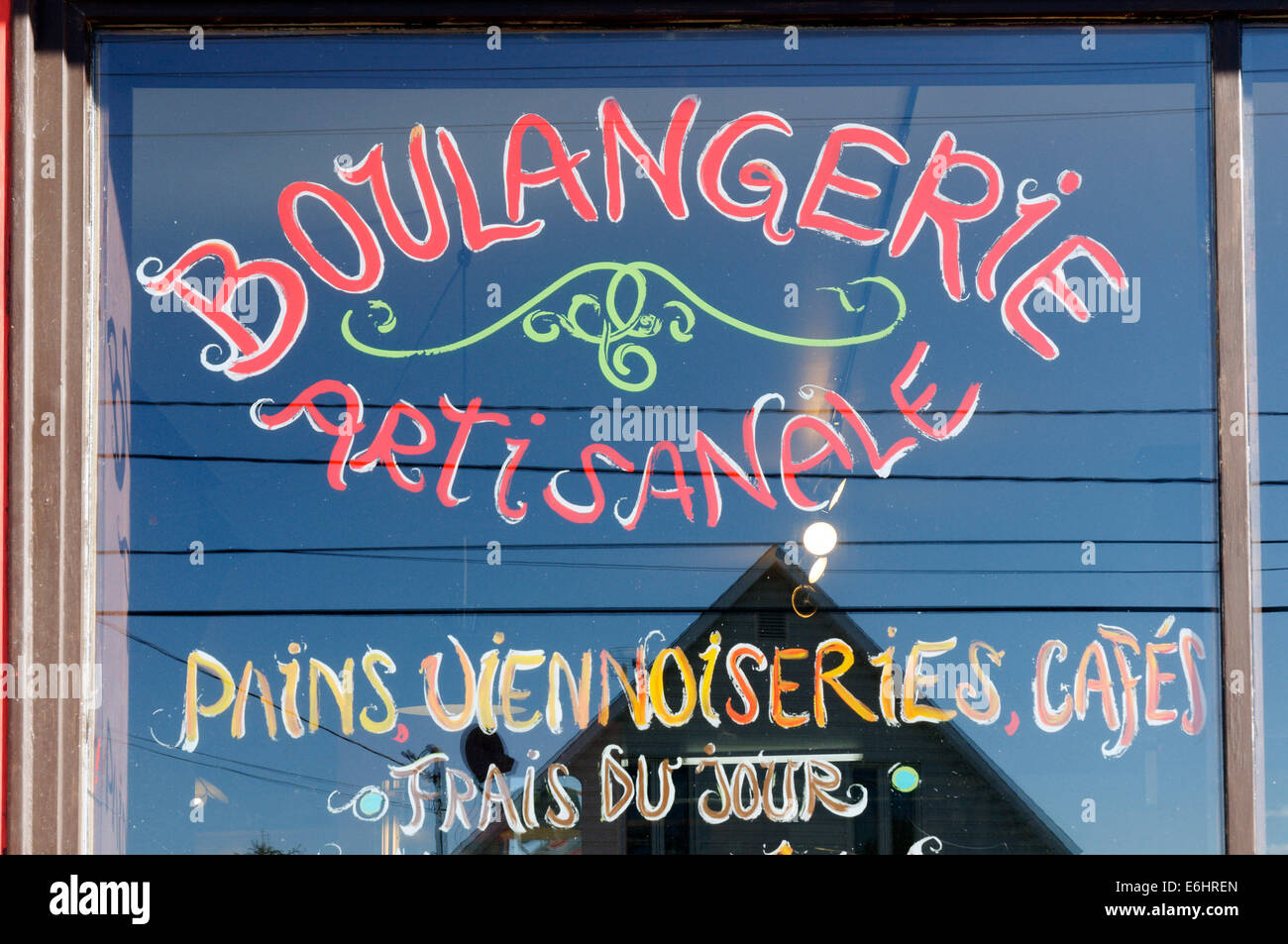 Shop window of an independent craft bakery in Quebec, a boulangerie artisanale - Stock Image
