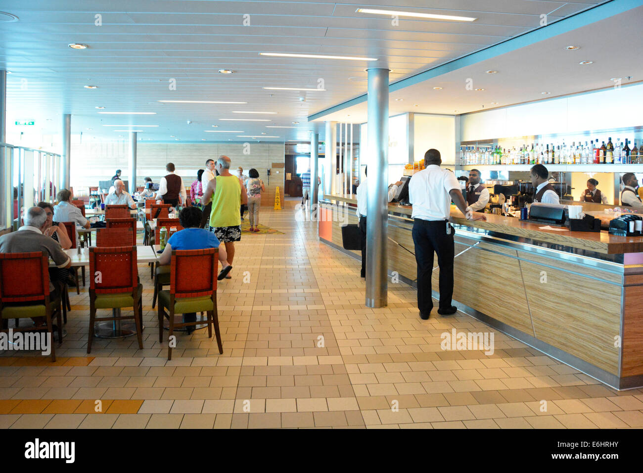 Cafeteria deck with breakfast buffet tables with bar counter open aboard a large Mediterranean cruise ship - Stock Image