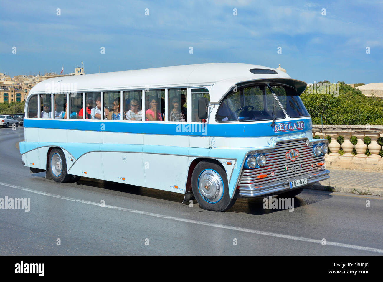 Tourists in an old Maltese Leyland bus on a sightseeing tour of Valletta Malta Europe - Stock Image