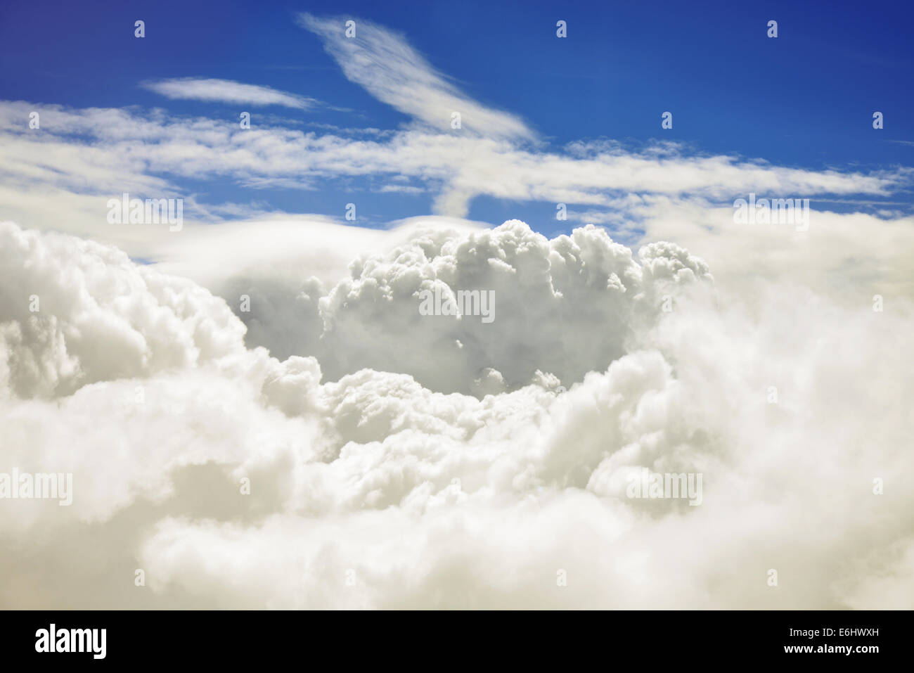 Aerial view of puffy white cumulonimbus clouds and sky. Stock Photo