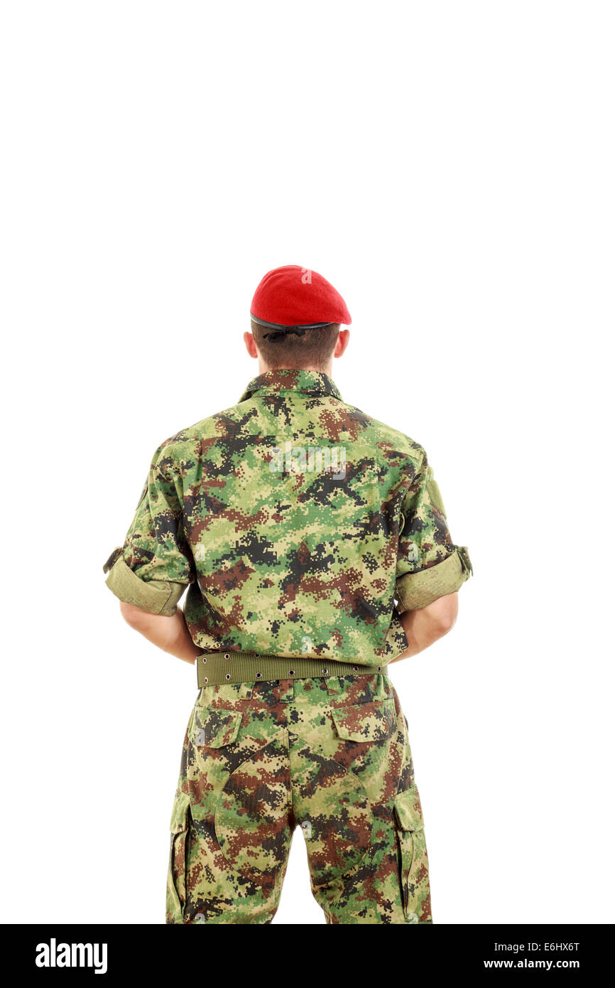 Military army soldier with turned back wearing uniform and cap Stock