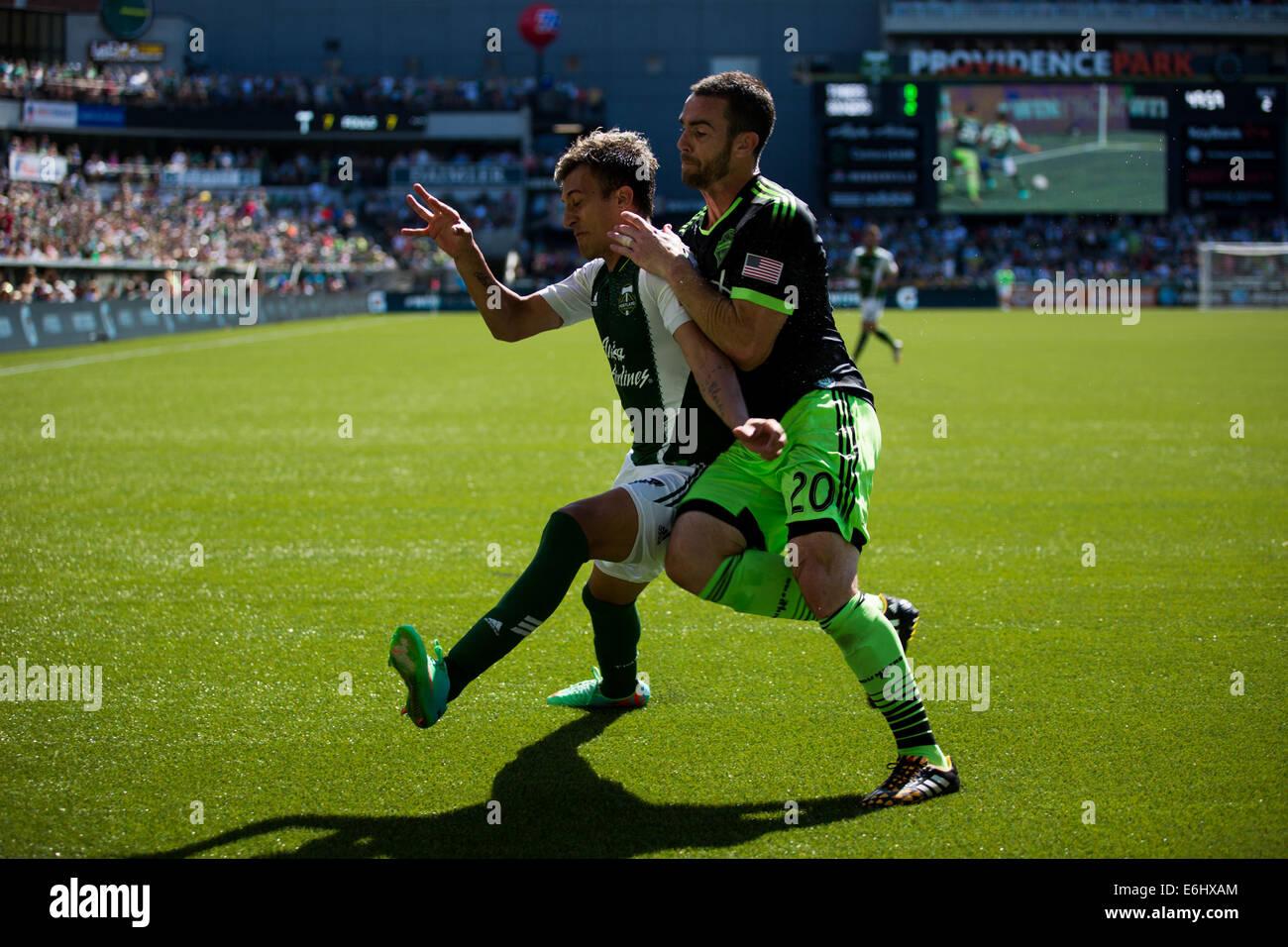 Aug. 24, 2014 - Portland's MAXIMILIANO URRUTI (37) trys to sheild against Seattle's ZACH SCOTT (20). The - Stock Image