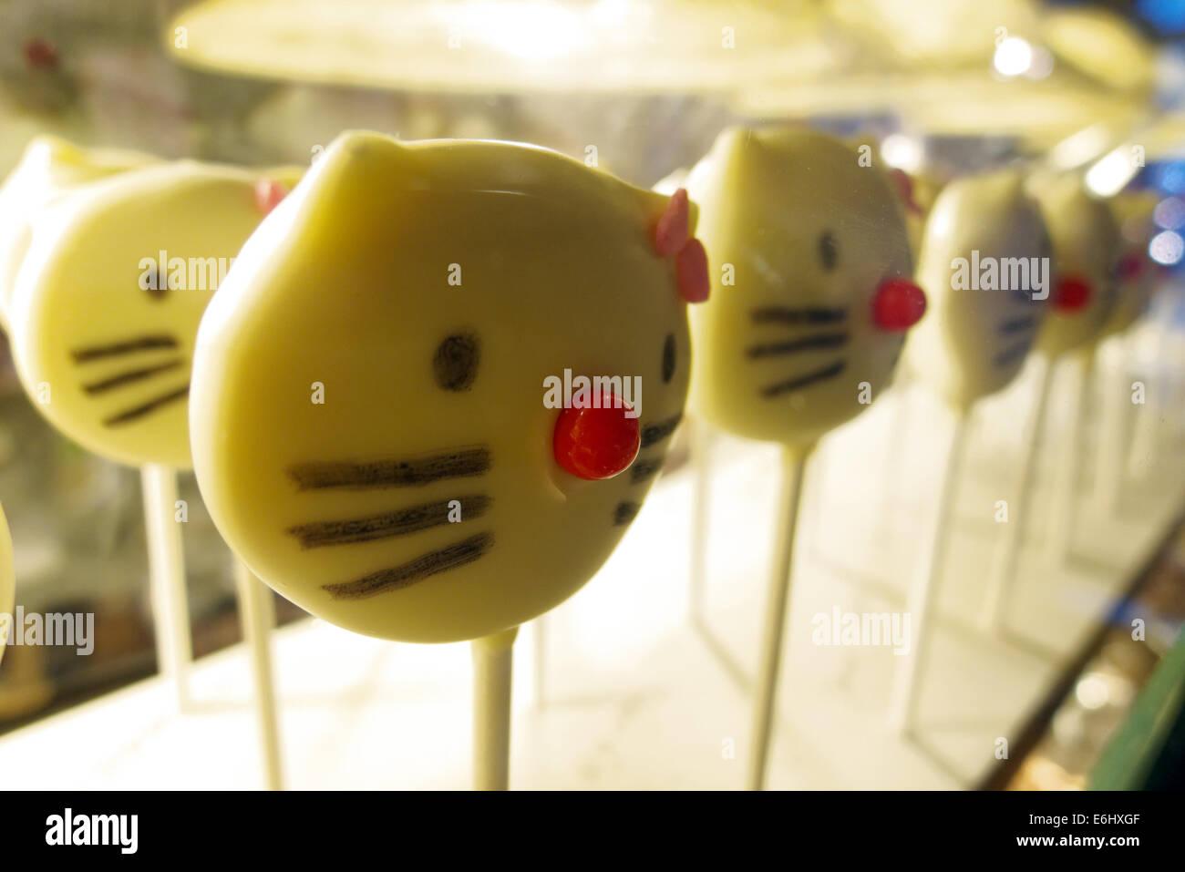 Hello Kitty fudge lollies - Stock Image