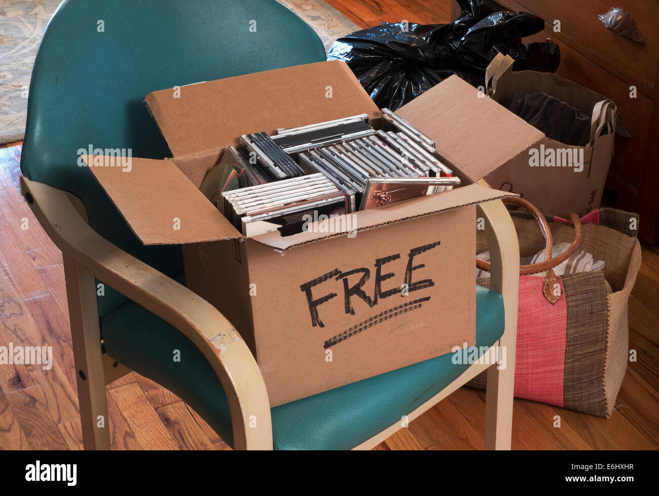 carton of free CDs and DVDs - Stock Image