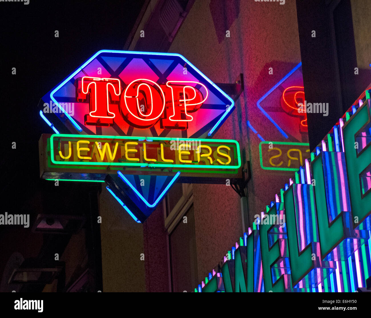 Top Indian Jewelers on the Rusholme Curry Mile, Manchester City Centre, England at Night - Stock Image