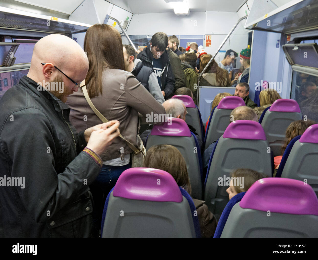 Congested Northern franchise train Warrington to Manchester Route - Stock Image