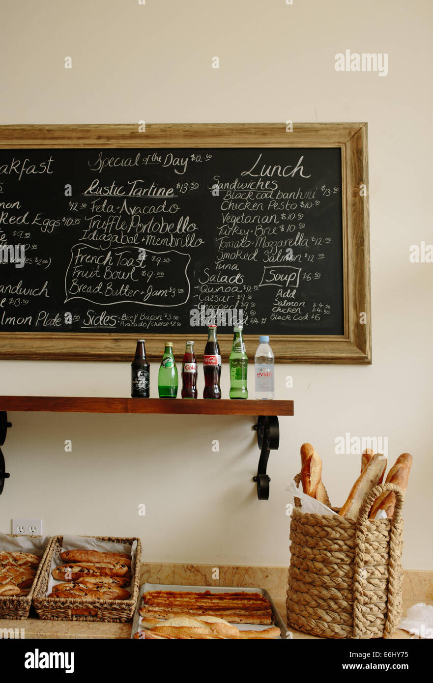 Handwritten Chalkboard Menu With Gold Frame At A French Bakery And Restaurant