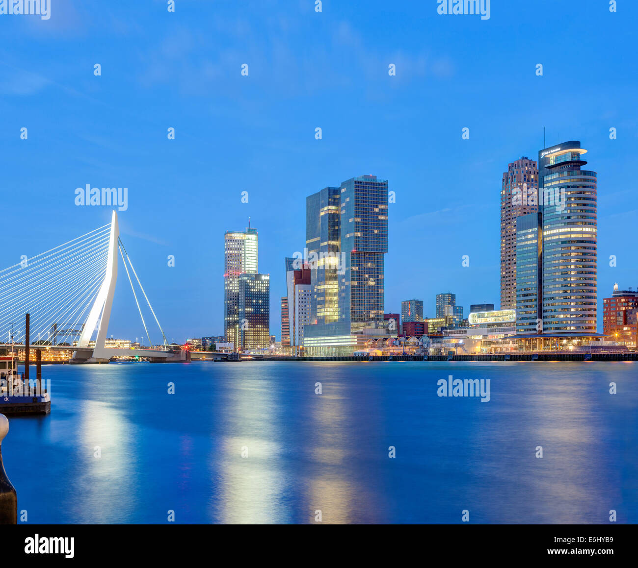 Rotterdam skyline cityscape. Erasmus Bridge and Wilhelmina Pier docklands Cruise Terminal modern buildings the Kop Stock Photo