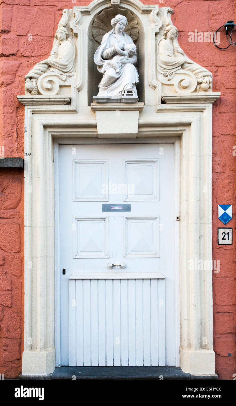 Madonna and Child above a period doorway in Bruges, Belgium Stock Photo