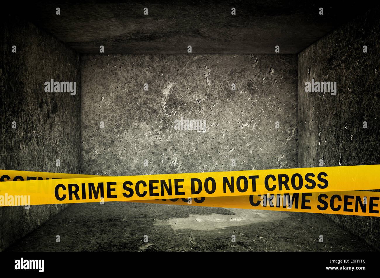 Crime Scene Do Not Cross Yellow Headband Tape in dark concrete interior. Crime Scene Police Ribbon. - Stock Image