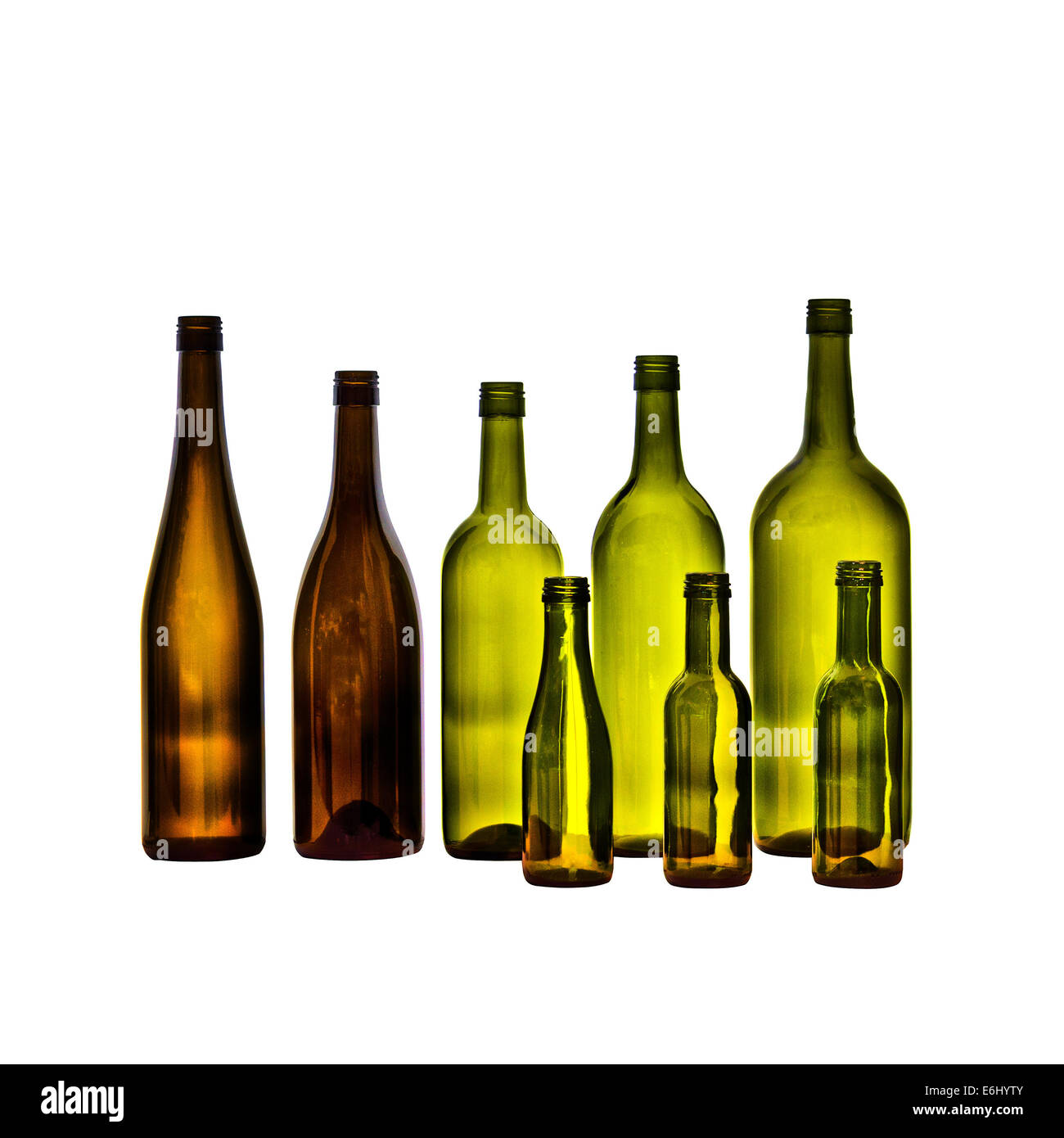 Empty glass wine bottles on white background. Bottles in various shapes and sizes. - Stock Image