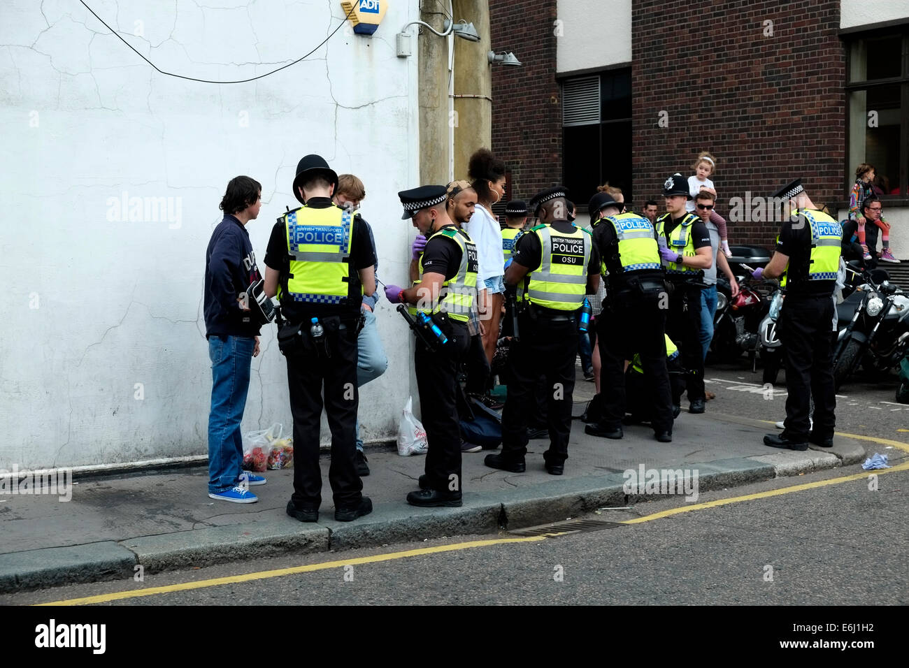 London, UK. 24th August, 2014. Notting Hill Carnival 2014. Police carry out stop and search on young Carnival goers - Stock Image