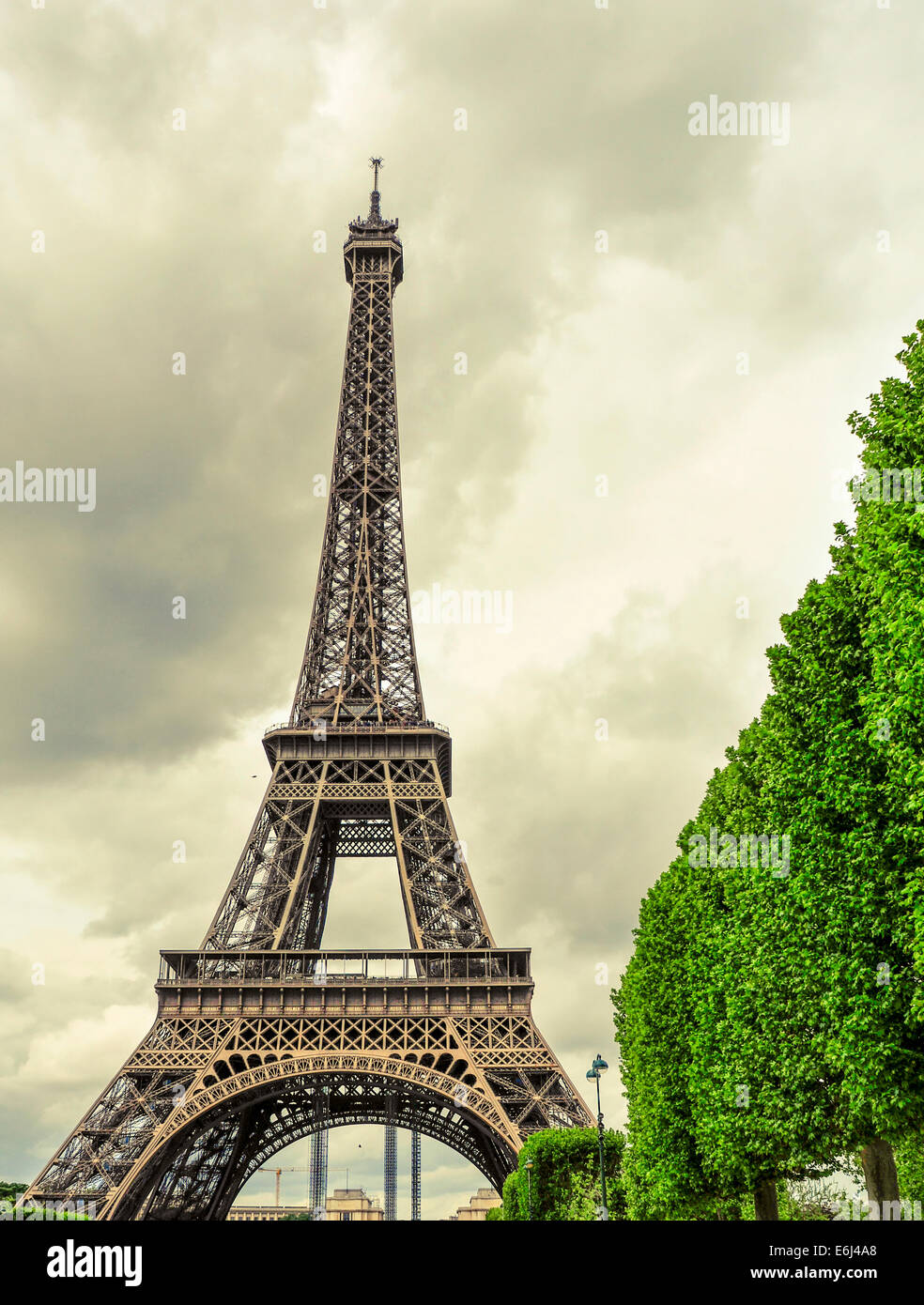 view of the Eiffel Tower in Paris, France, with an effect of old postcard - Stock Image