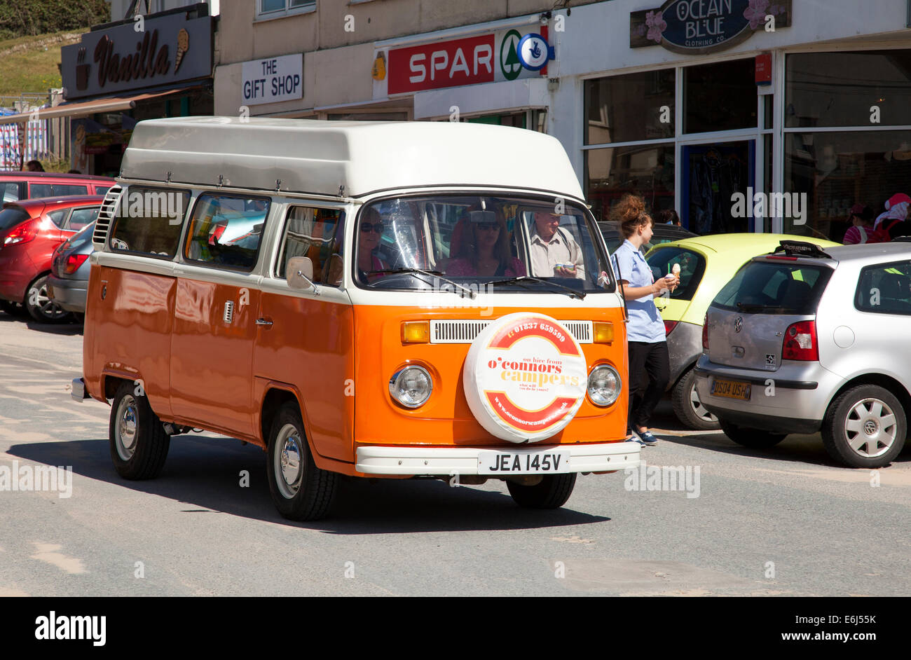 A classic VW campervan in Polzeath, Cornwall, England, U.K. - Stock Image